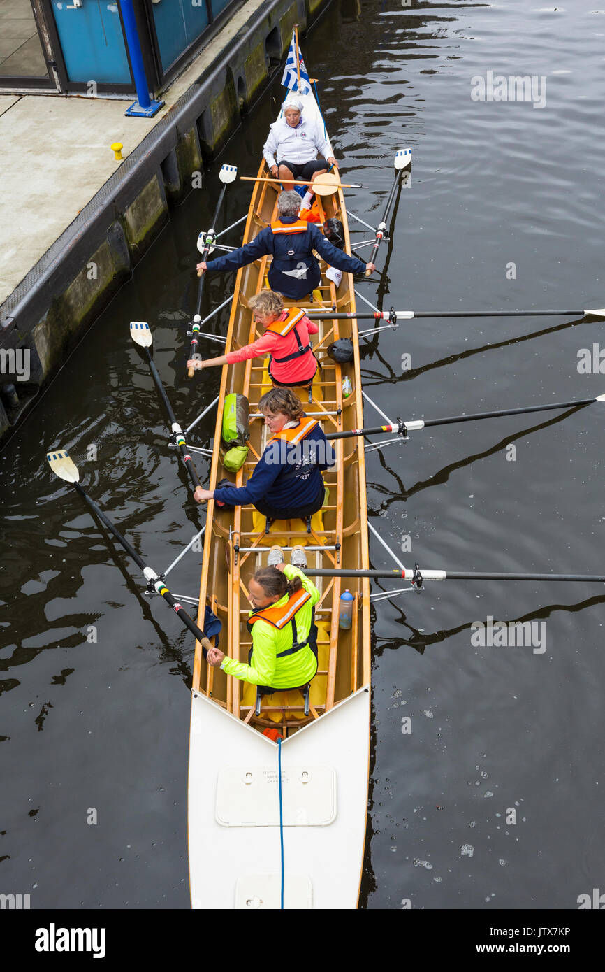 Coxed four all-woman middle age and senior/elderly crew in rowing boat prepare to practice on river in Hamburg - Stock Image