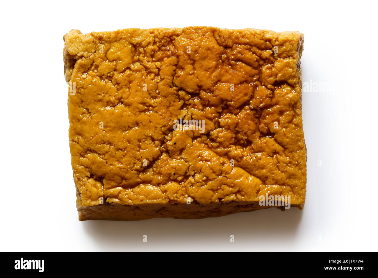 Single block of smoked tofu isolated on white from above. - Stock Image