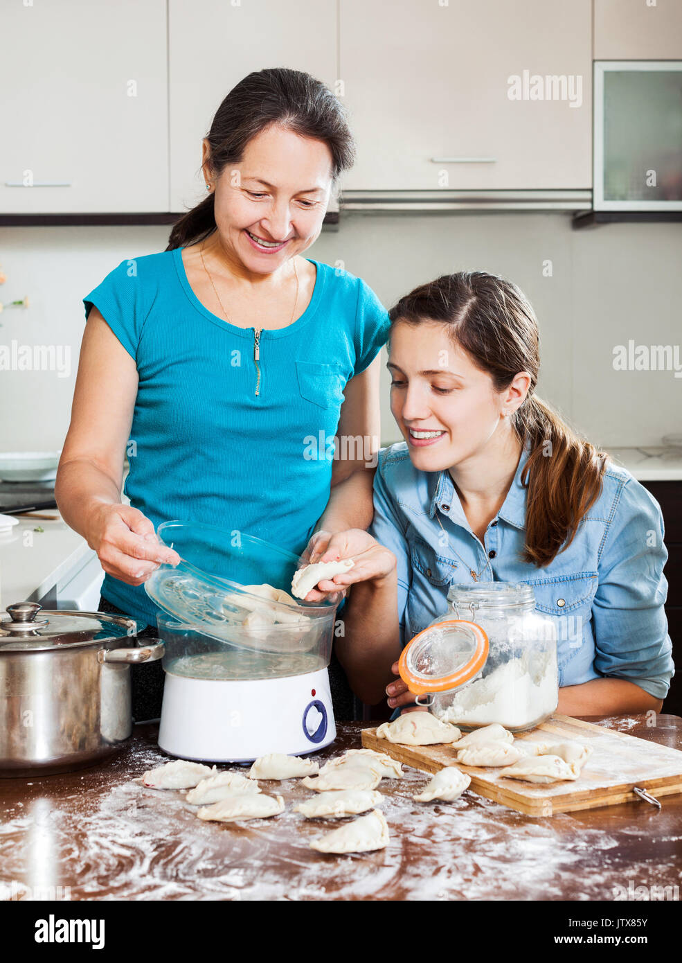 Mature Woman Cooking Food Steamer Stock Photos & Mature Woman ...