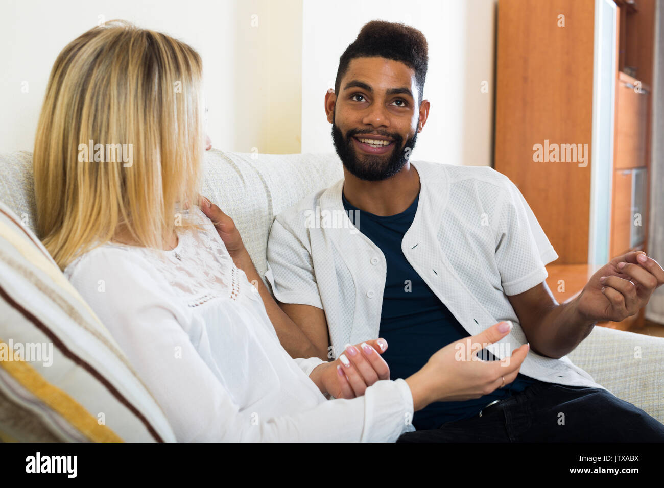 Portrait of happy spouses joking and smiling indoors Stock Photo