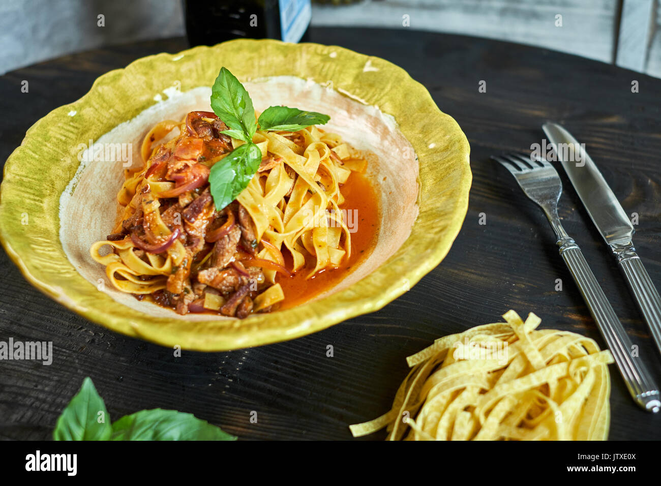 Italian penne pasta with tomatoes and pesto in a restaurant jpg Stock Photo