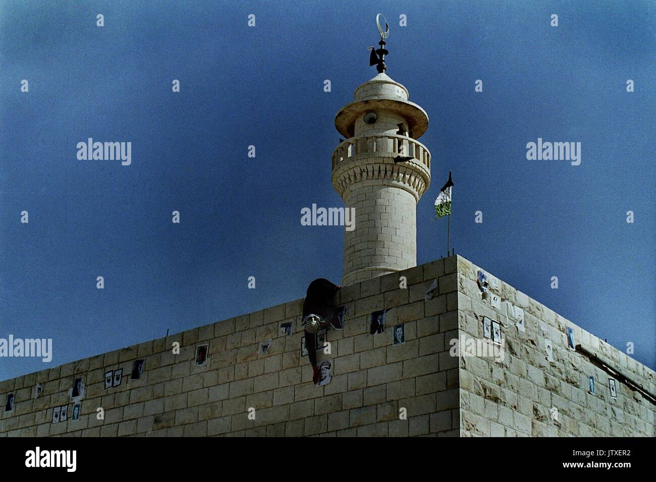 Militant Palestinians pictured during the Intifada 1990.The Arab-Israeli conflict is a struggle over land, history and religion. It's also a dispute over who owns Jerusalem and its holy sites.  To Jews, Jerusalem, Yerushalayim, is the historical capital of the biblical Israelites. To Muslims, Al Quds or Bayt al-Maqdis is the third holiest site in Islam. The most sensitive area is the walled old city and the holy site of Har Ha-Bayt (Temple Mount), and al-Haram al-Sharif (The Noble Enclosure), the al-Aqsa Mosque and the Dome of the Rock The transfer of rule over Jerusalem since the end of the C - Stock Image