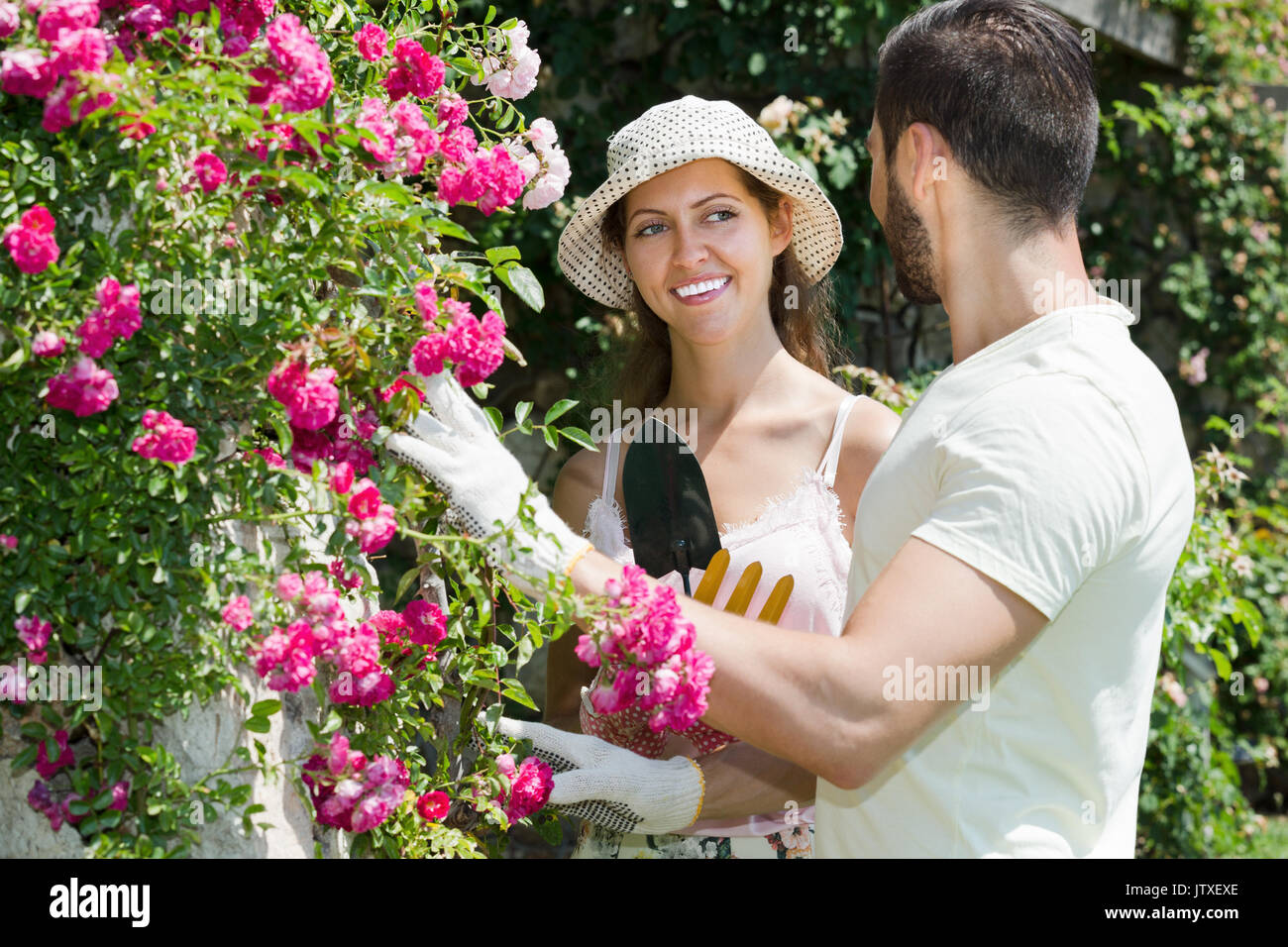 Happy family in garden flowers with horticultural sundry for planting Stock Photo