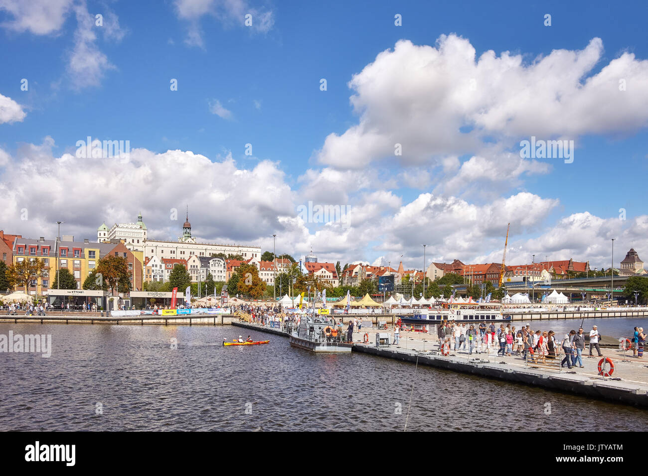 Szczecin, Poland – August 06, 2017: Visitors cross Oder river with military floating bridge during final of The Tall Ships Races 2017. - Stock Image