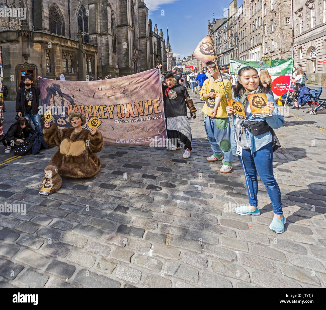 GGIRI & WINS from Korea promoting their show Monkey Dance at Edinburgh Festival Fringe 2017 in the High Street of the Royal Mile Edinburgh Scotland UK - Stock Image