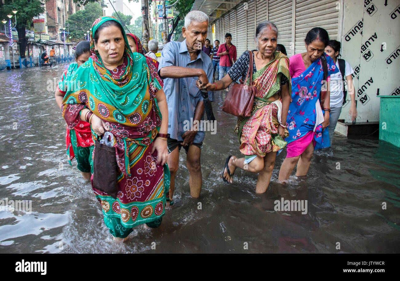Monsoon shows a different scenario every year in Calcutta.Waterlogged roads,unavailable transport,working people Stock Photo
