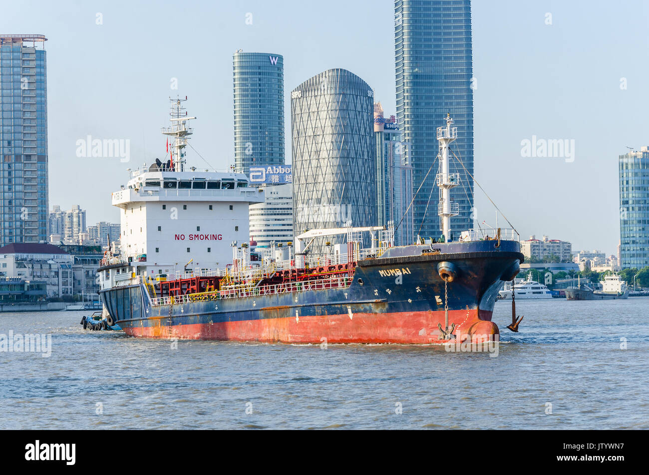 A cargo vessel registered in Mumbai, India travels up the Huangpu River in Shanghai, China. Stock Photo