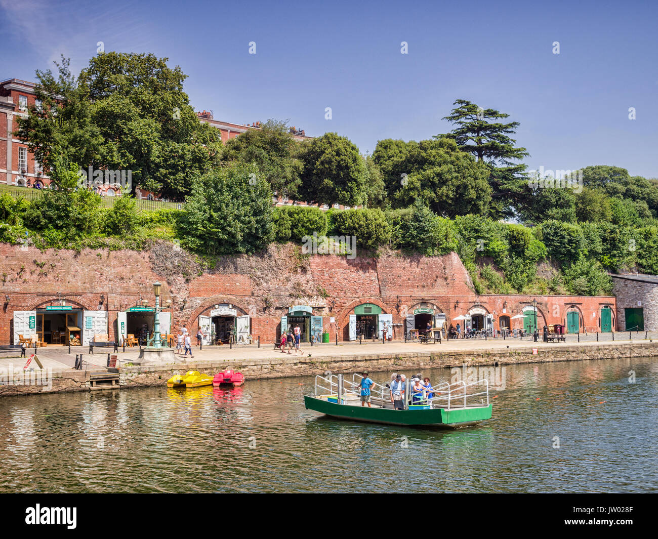 21 June 2017: Exeter Quayside, Exeter, Devon, England, UK - Butts Ferry, a hand powered cable ferry , crossing the River Exe towards the shops and gal - Stock Image