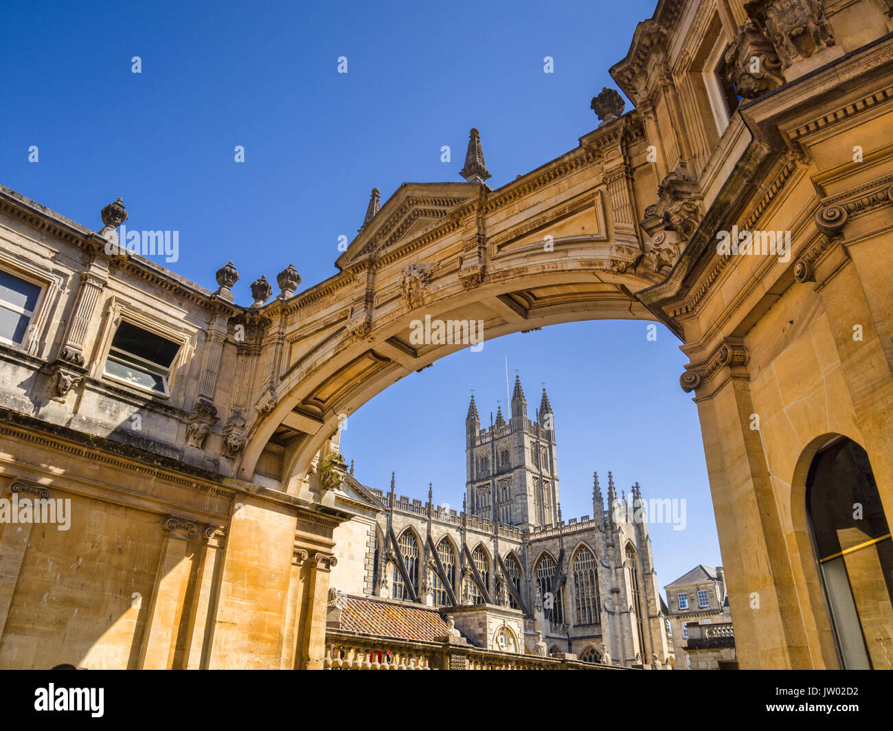 Bath, Somerset, England, UK - Bath Abbey seen through the York Street Arch. - Stock Image