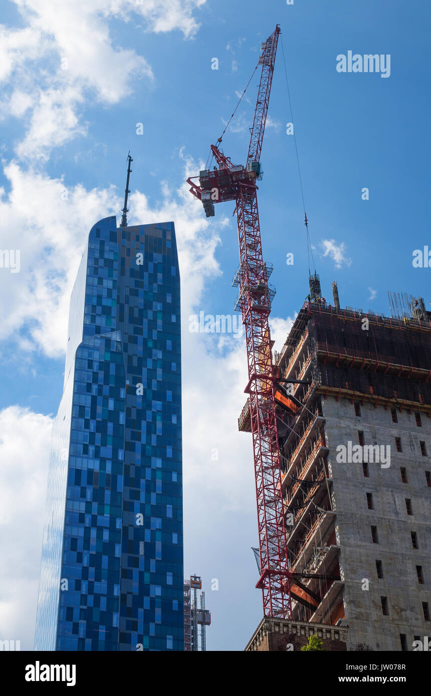 Skyscraper construction continues along 57th Street in Manhattan in New York City. One57 is on the left. - Stock Image