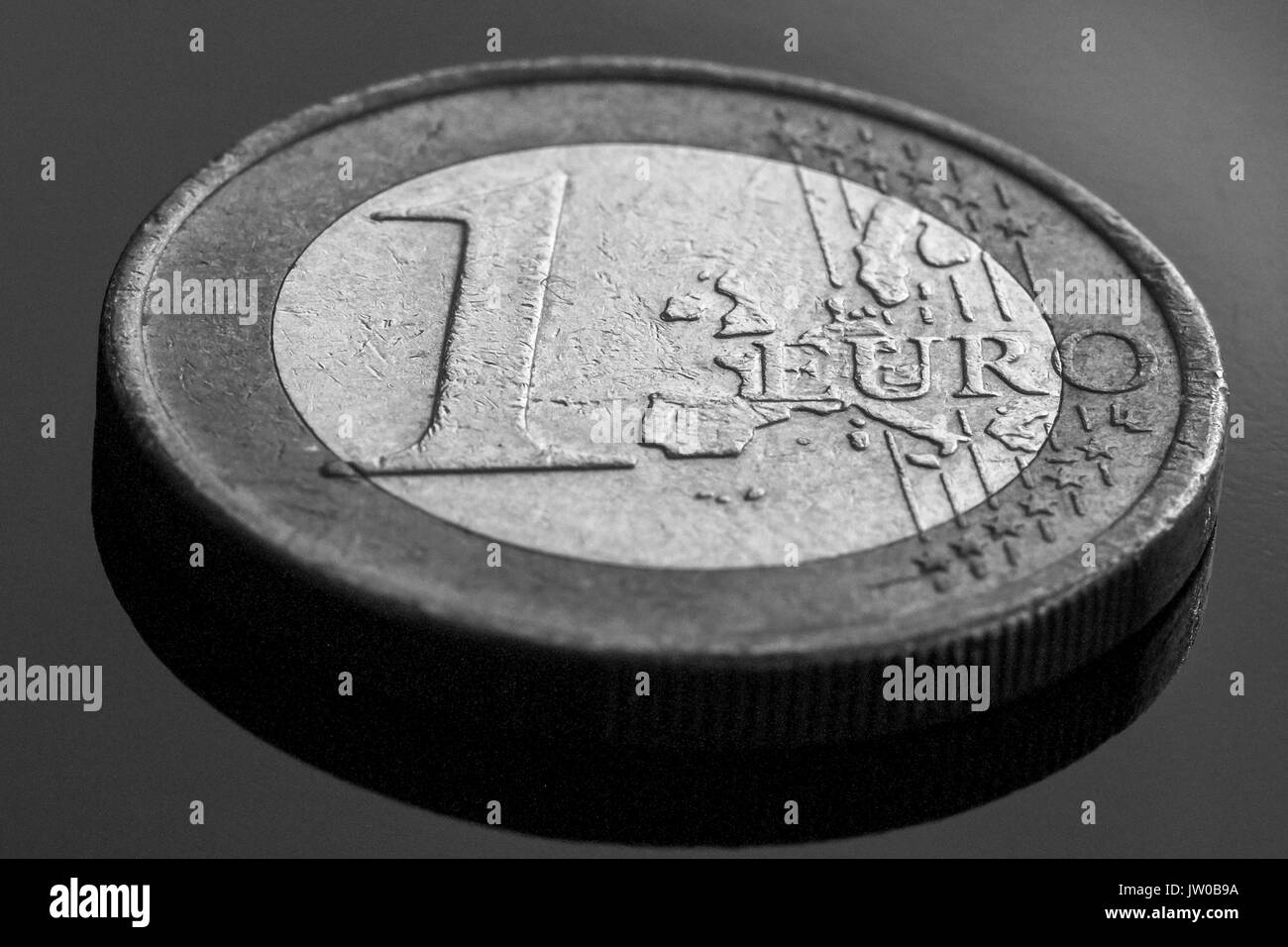 One euro coin close uo view, black background, black and white conversion - Stock Image