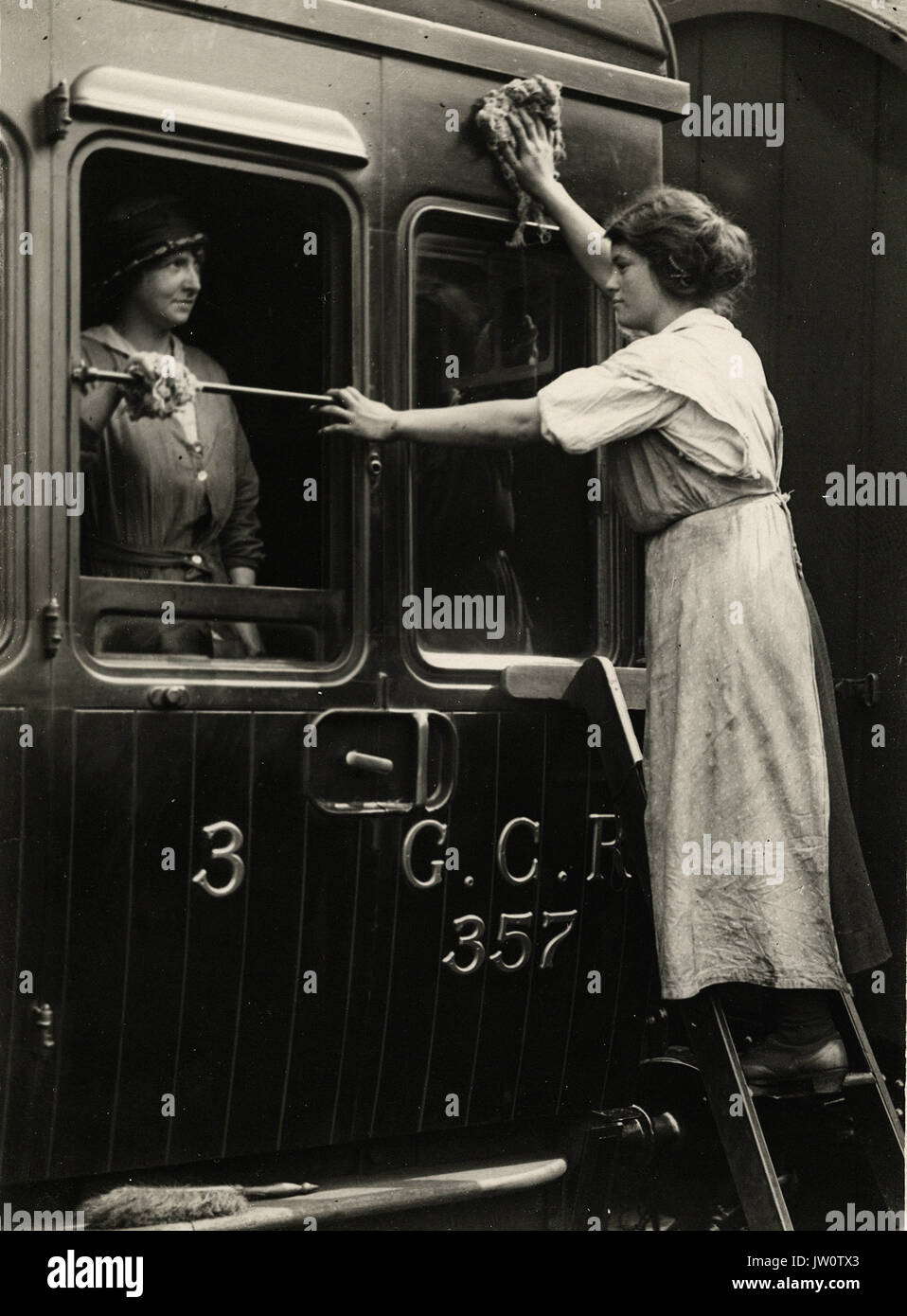 Railway workers cleaning carriages - Alternative Title: Women's Work - Stock Image