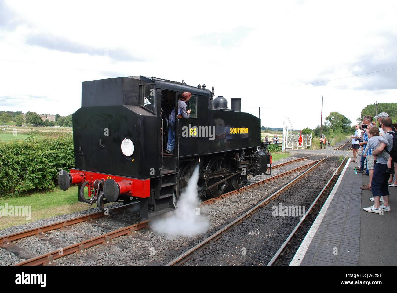 Southern Railway 0-6-0T USA class steam locomotive number 65 switches tracks at Bodiam on the Kent and East Sussex Railway in East Sussex, England. - Stock Image