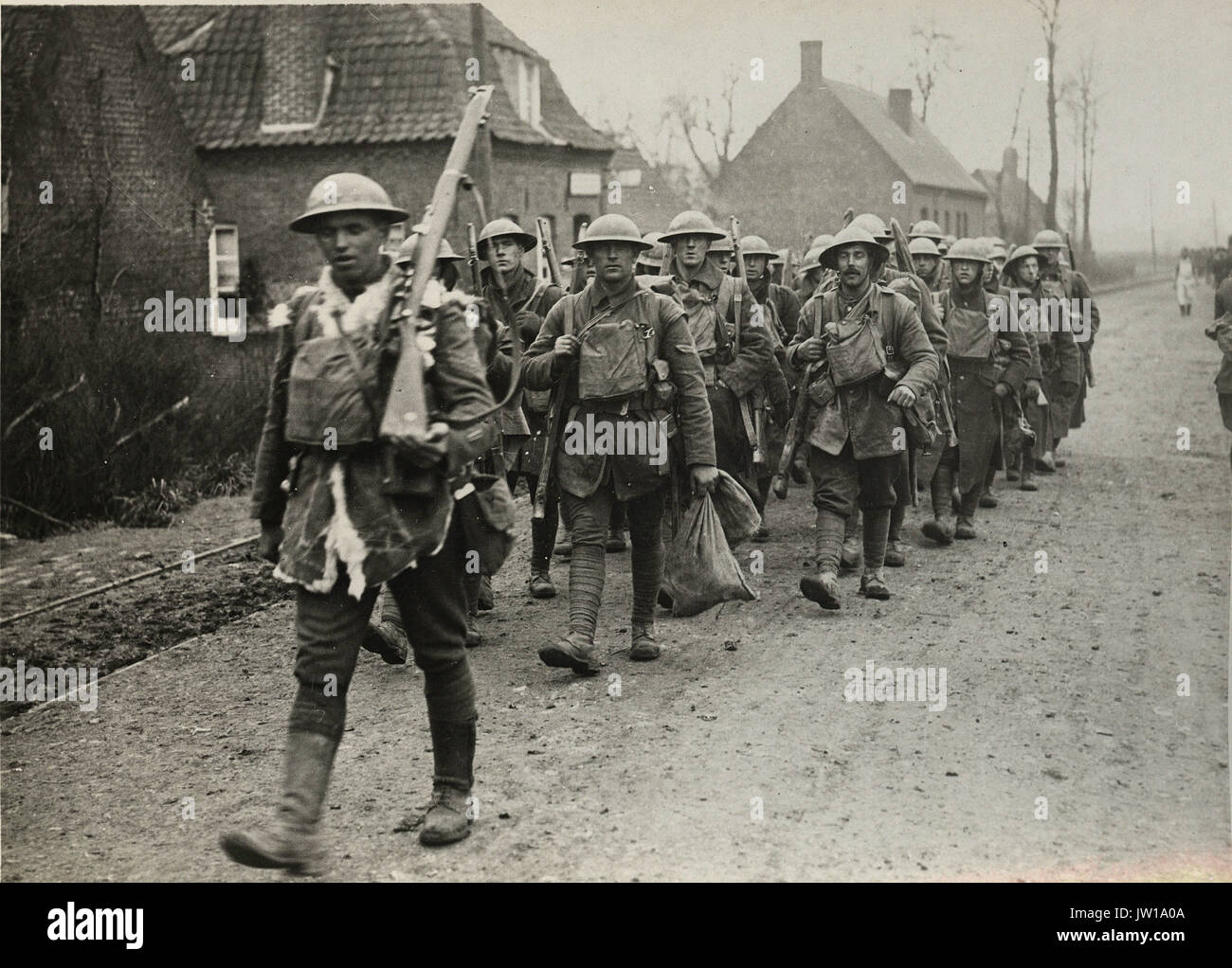 Official photograph taken on the British Western Front in France _ The German offensive - Some of the gallant 55th going for a short rest after fighting hard - - Stock Image