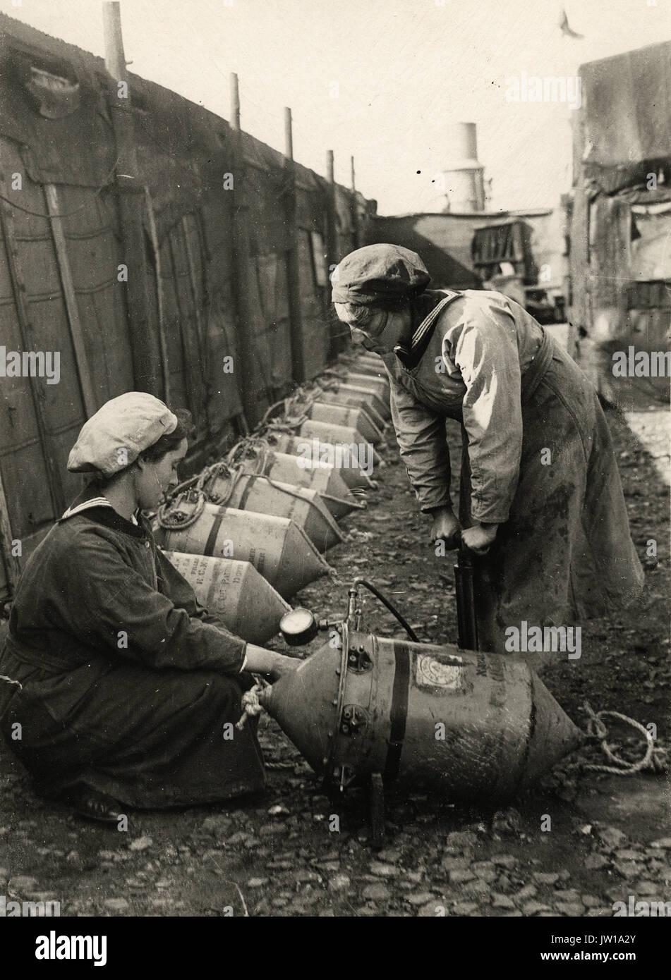 Women testing a mine with air presssure - Alternative Title: Women's Work - Stock Image