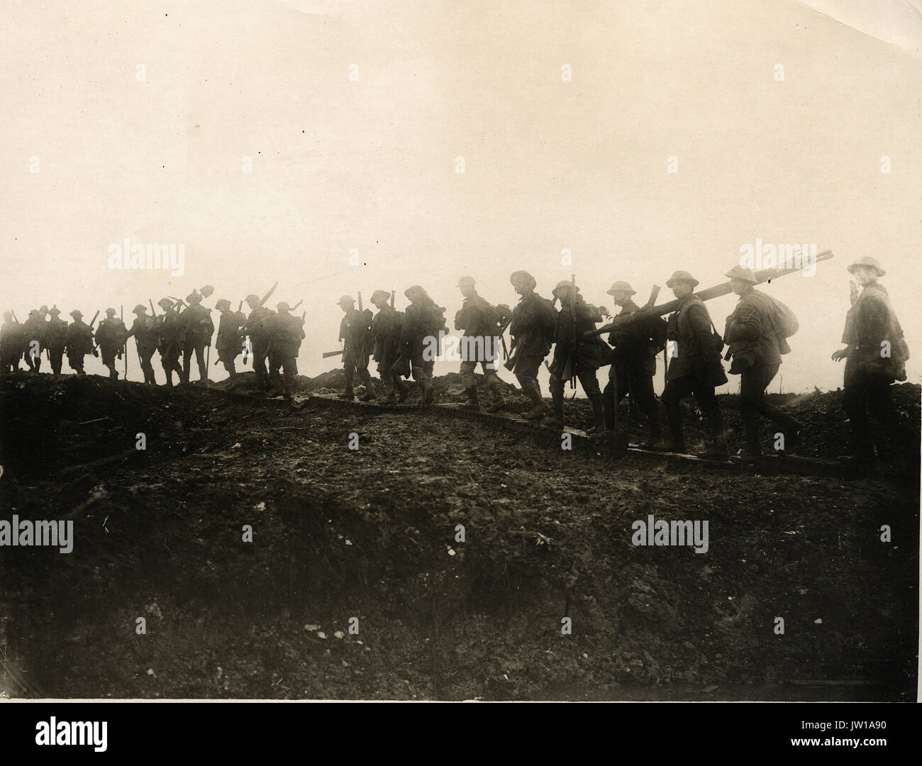 Where spades and picks are useful as rifles - Alternative Title: Official Photograph of the Somme Advance  Description: Working parties go up to consolidate newly captured trenches - Stock Image