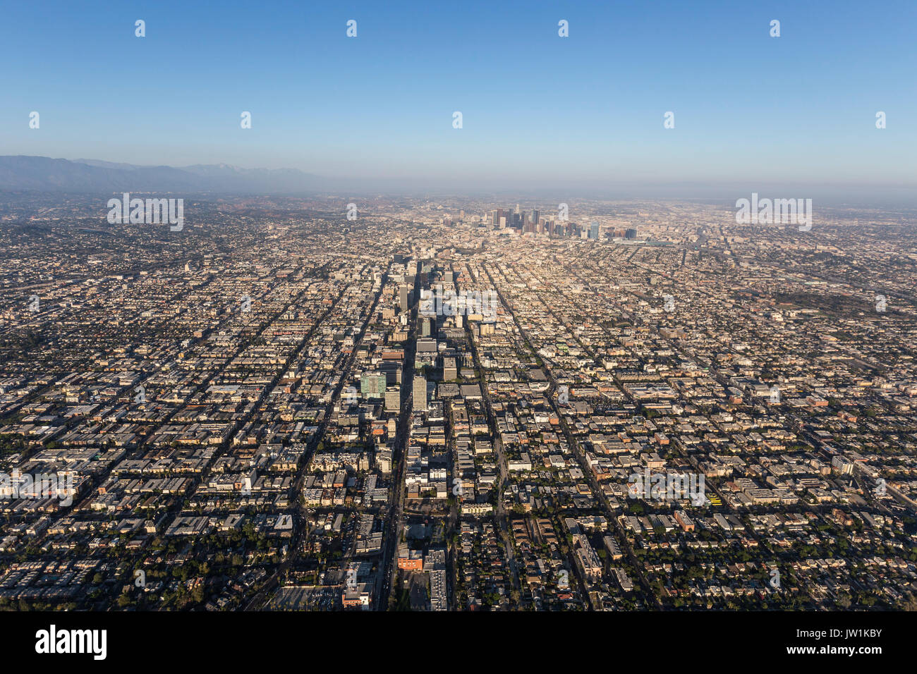 Smoggy summer afternoon aerial view of the Wilshire District and downtown Los Angeles in Southern California. - Stock Image