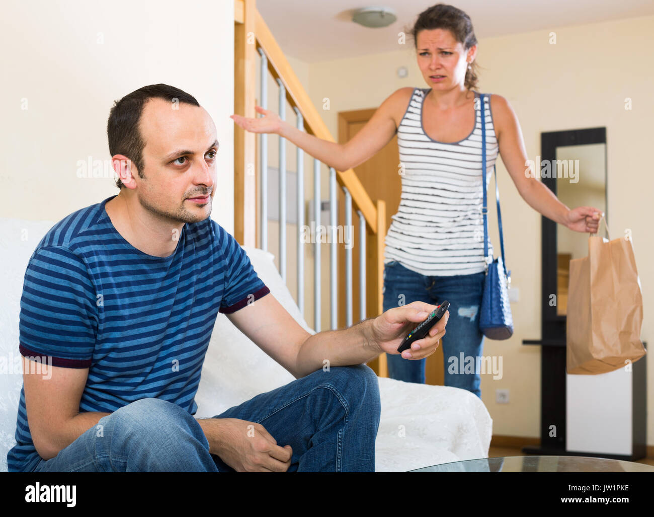Upset spanish wife and furious husband discussing divorce