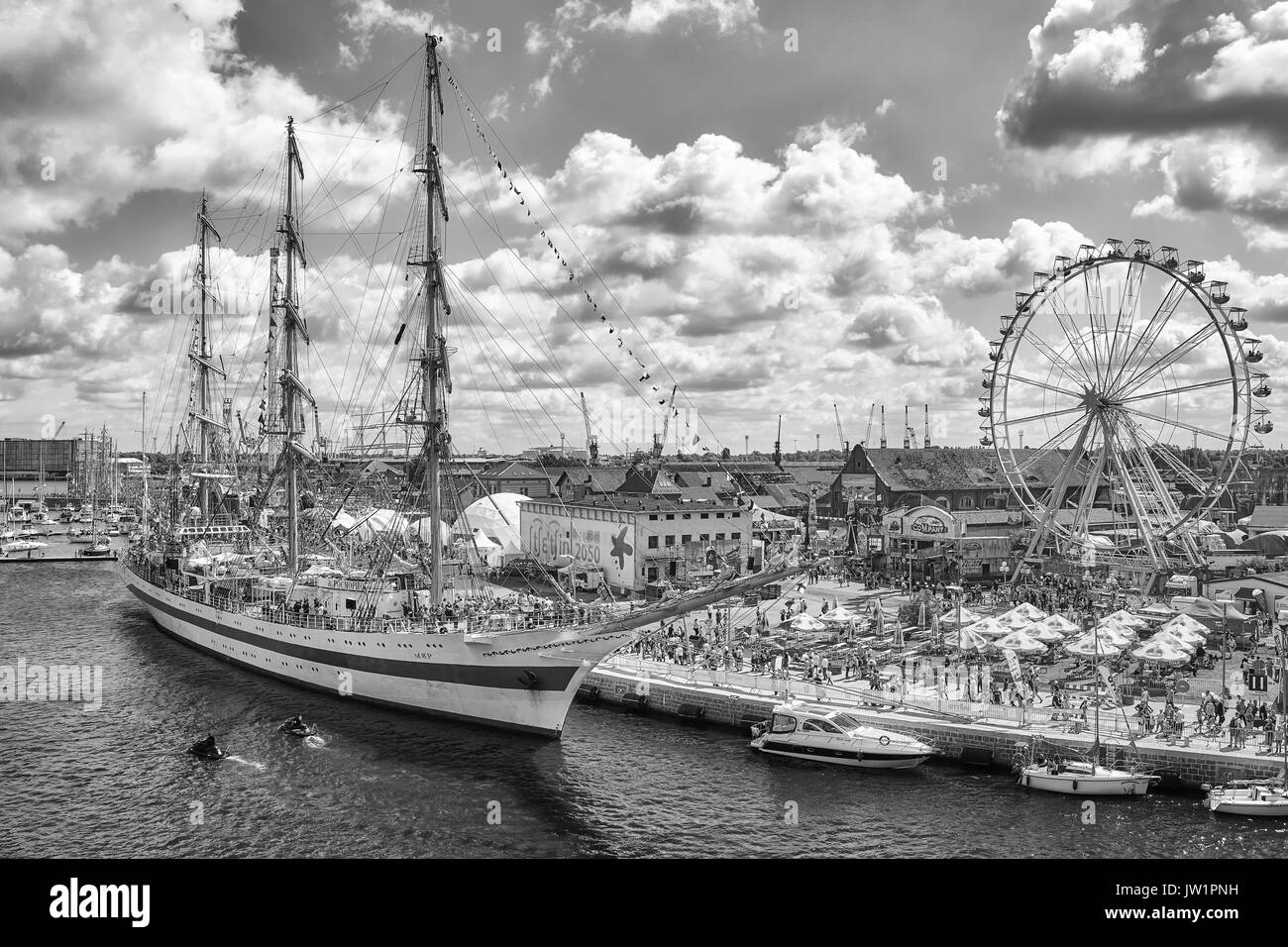 Szczecin, Poland - August 06, 2017: Sailing vessels and an amusement park on Lasztownia island at the Final of The Tall Ships Races 2017 in Szczecin. - Stock Image