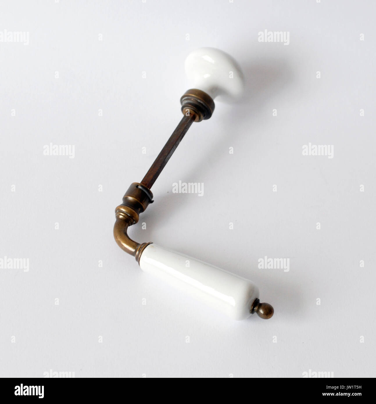 Vintage knob door made by brass and porcelain - Stock Image