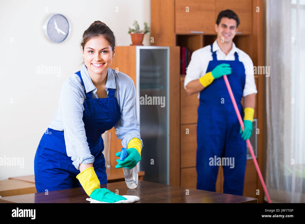 https://c8.alamy.com/comp/JW1TGP/professional-cleaners-cleaning-and-dusting-in-ordinary-apartment-JW1TGP.jpg