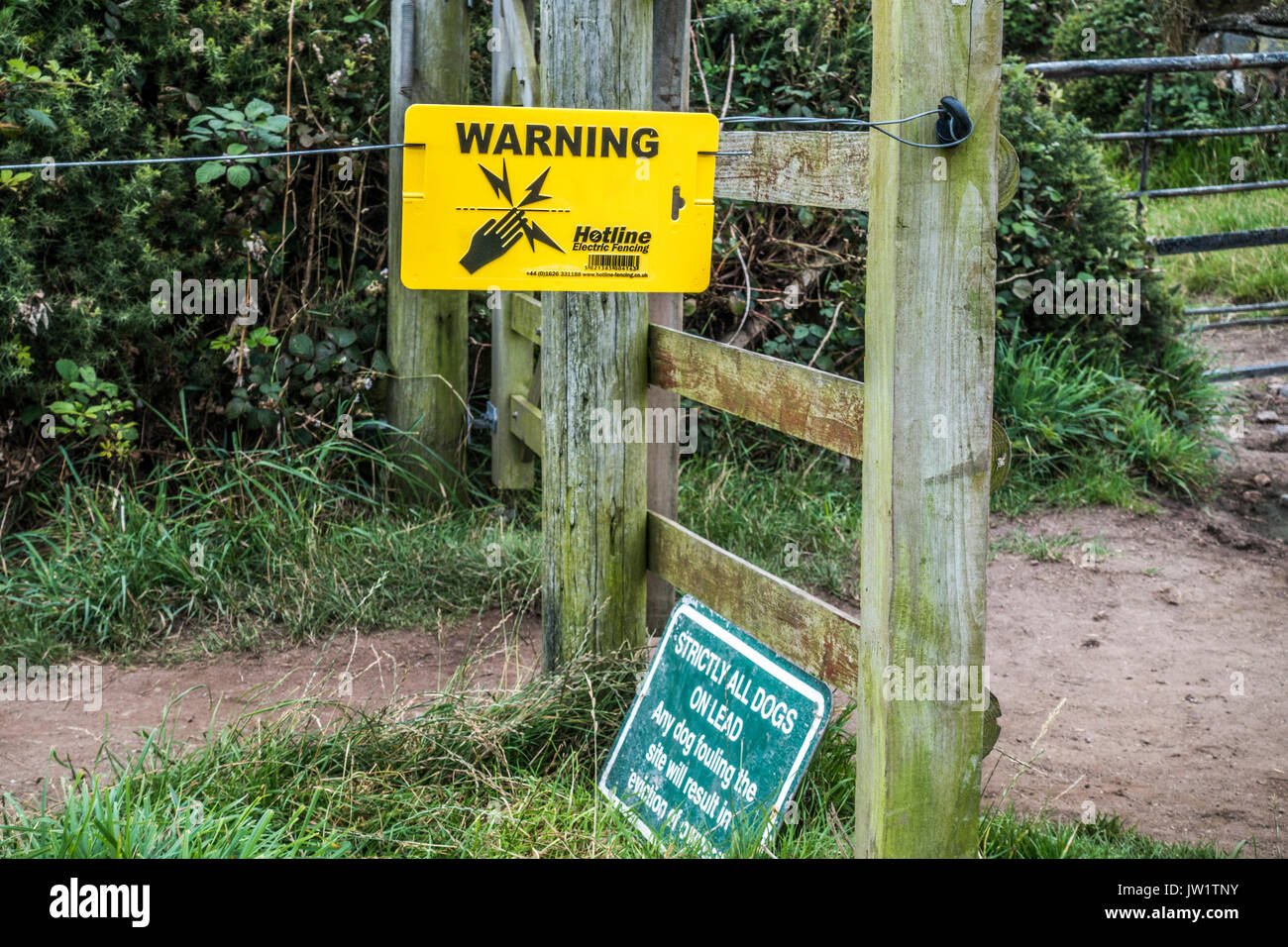 Warning sign for Hotline electric fencing, to counter straying cattle. Sennen, Cornwall, England, UK. - Stock Image