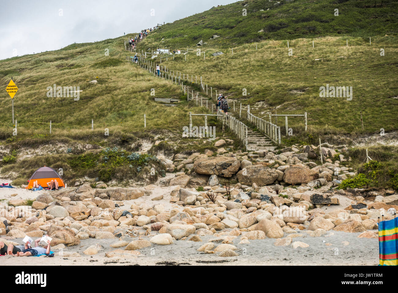 People on the steep path to Gwynver Beach, near Penzance, Cornwall, England, UK. - Stock Image