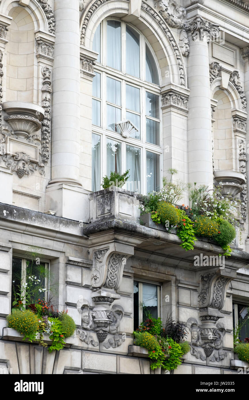 The facade of the Hotel De Ville, Tours, France, with well planted window boxes. - Stock Image