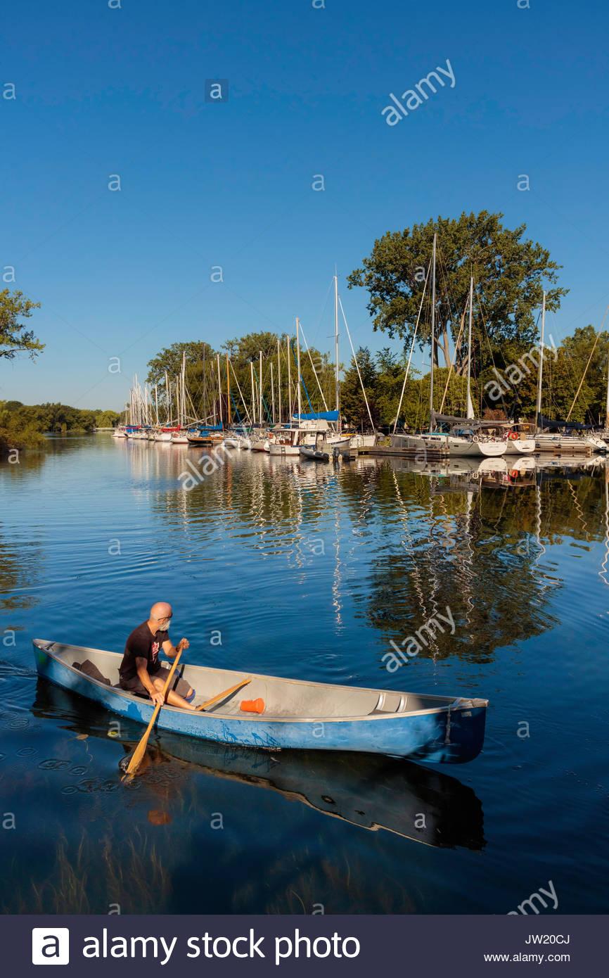 canoe canoeing Toronto Islands Park lagoon trees reflected Toronto Ontario Canada Stock Photo