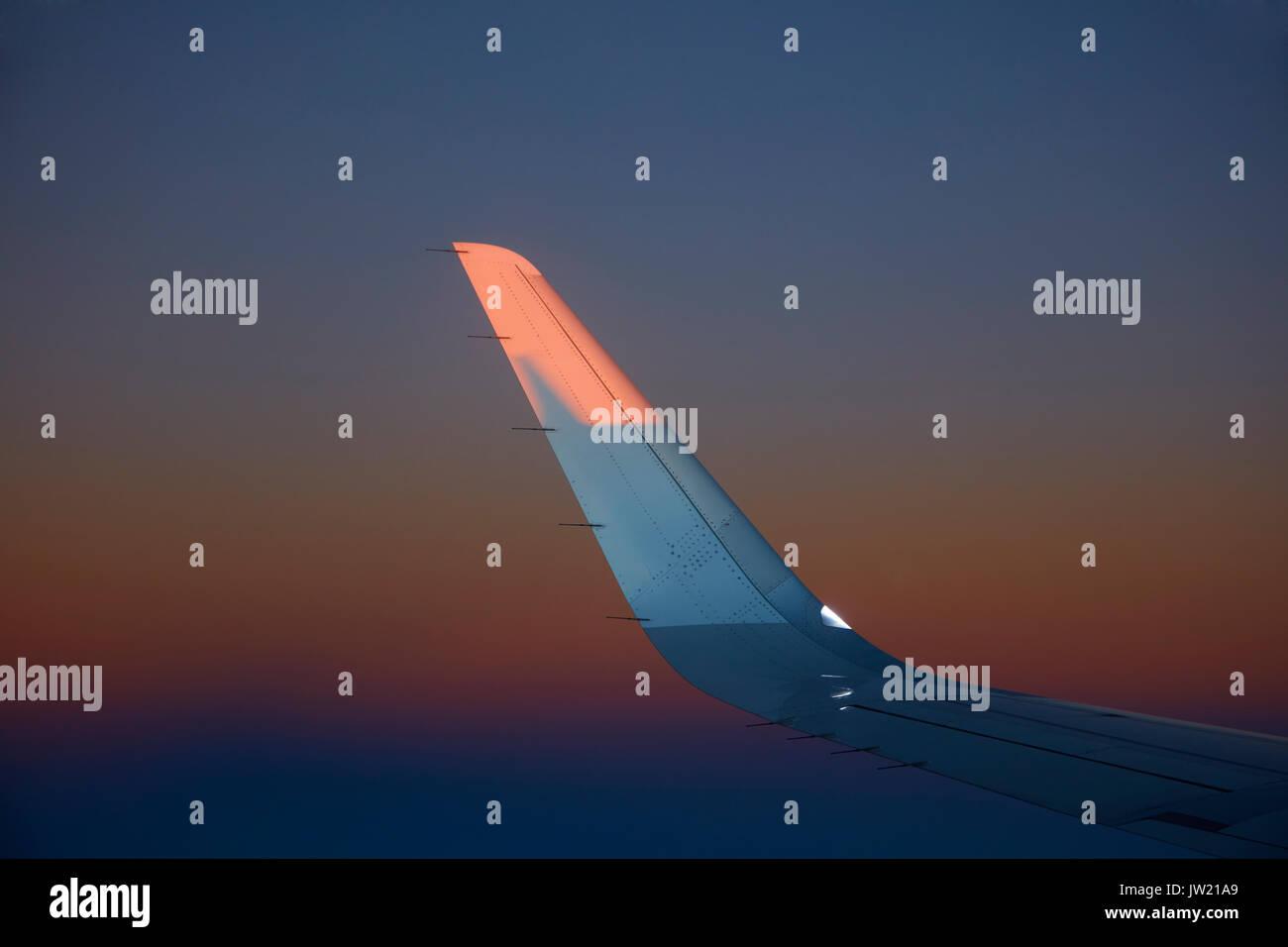 Sunrise on wingtip over Atacama Desert, Northern Chile, South America - Stock Image