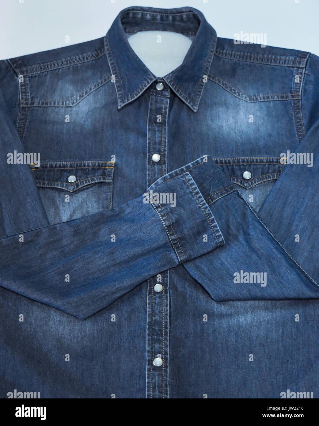 front of denim shirt in blur - Stock Image