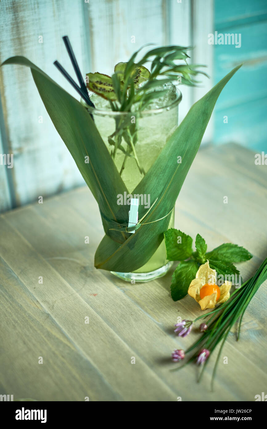 Homemade lemonade from fresh tarthun with lime in glass glasses, selective focus jpg Stock Photo