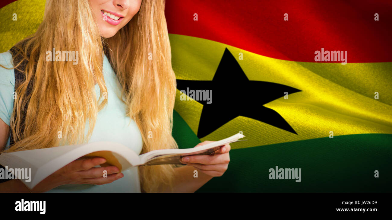 Happy student against digitally generated ghana national flag - Stock Image