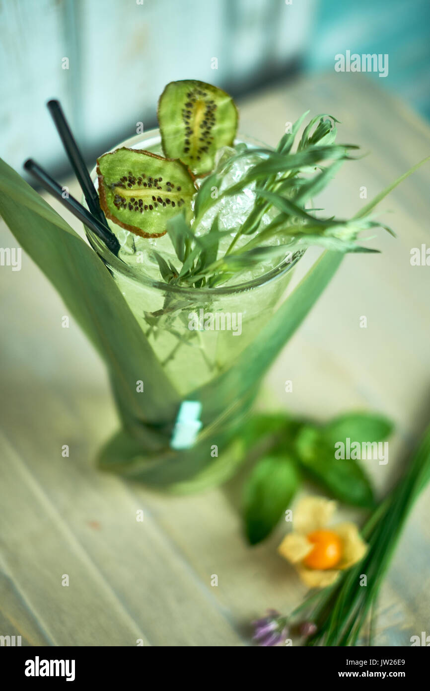 Homemade lemonade from fresh tarthun with lime in glass glasses, selective focus jpg - Stock Image