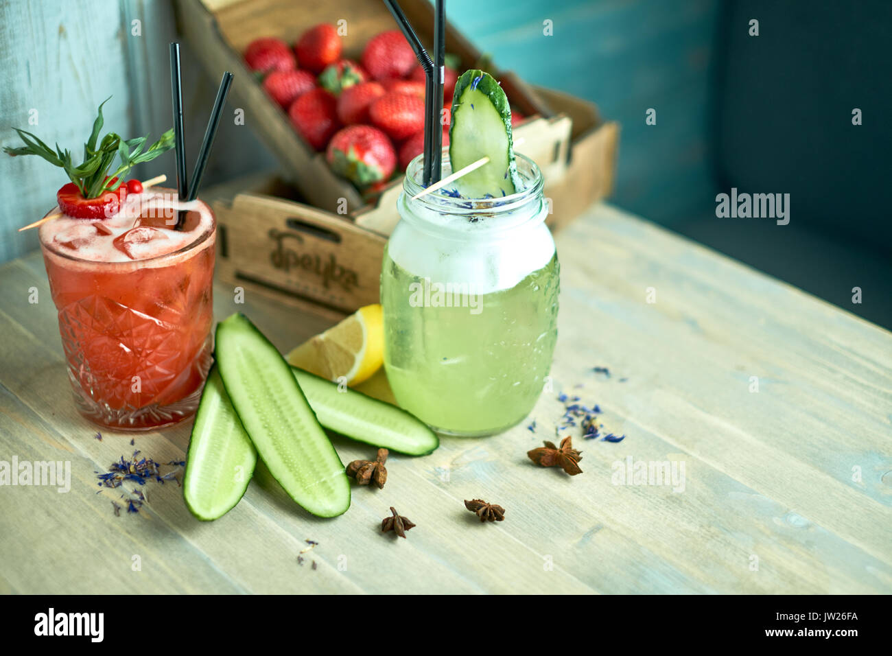 Homemade cucumber and mint lemonade in a glass on a blue wooden background. jpg - Stock Image