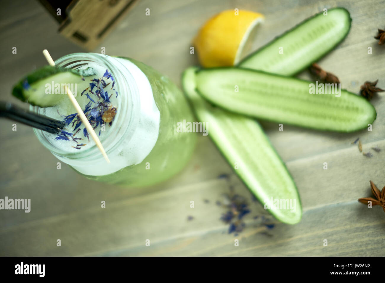 Homemade cucumber and mint lemonade in a glass on a blue wooden background. jpg Stock Photo
