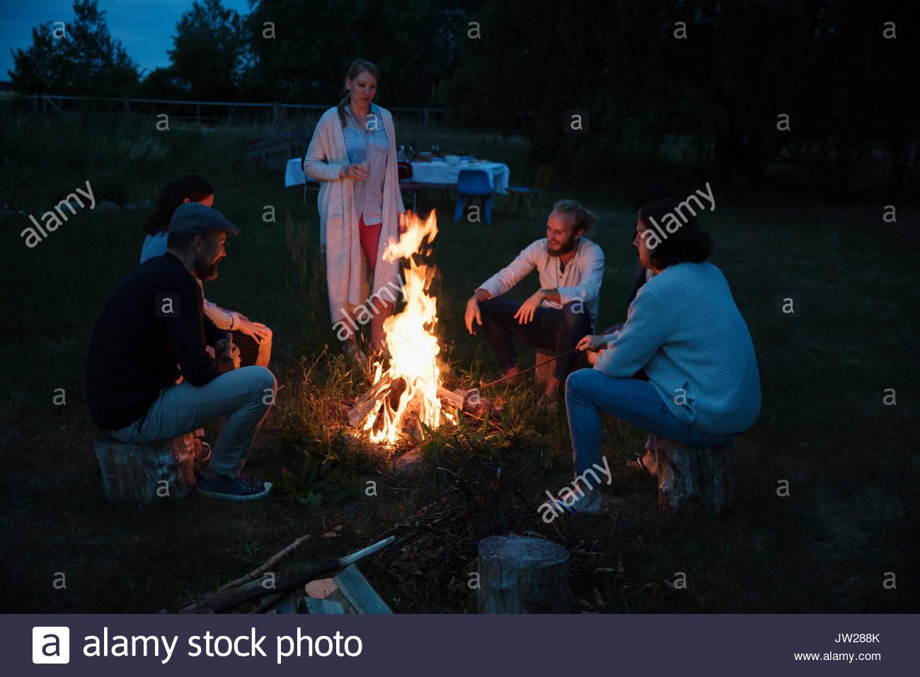 Friends enjoying summer campfire - Stock Image