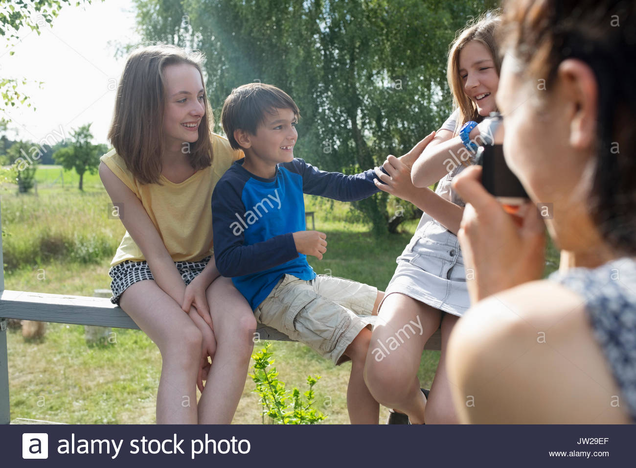 Playful family in rural summer yard - Stock Image
