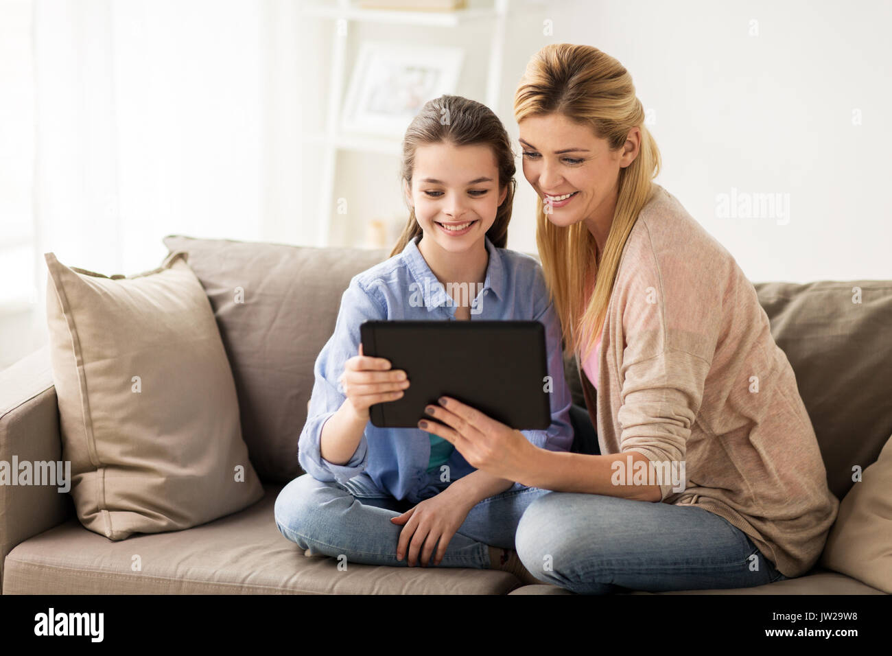 happy family with tablet pc at home - Stock Image