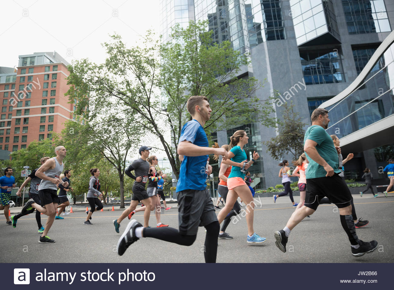 Marathon runners running on urban street - Stock Image