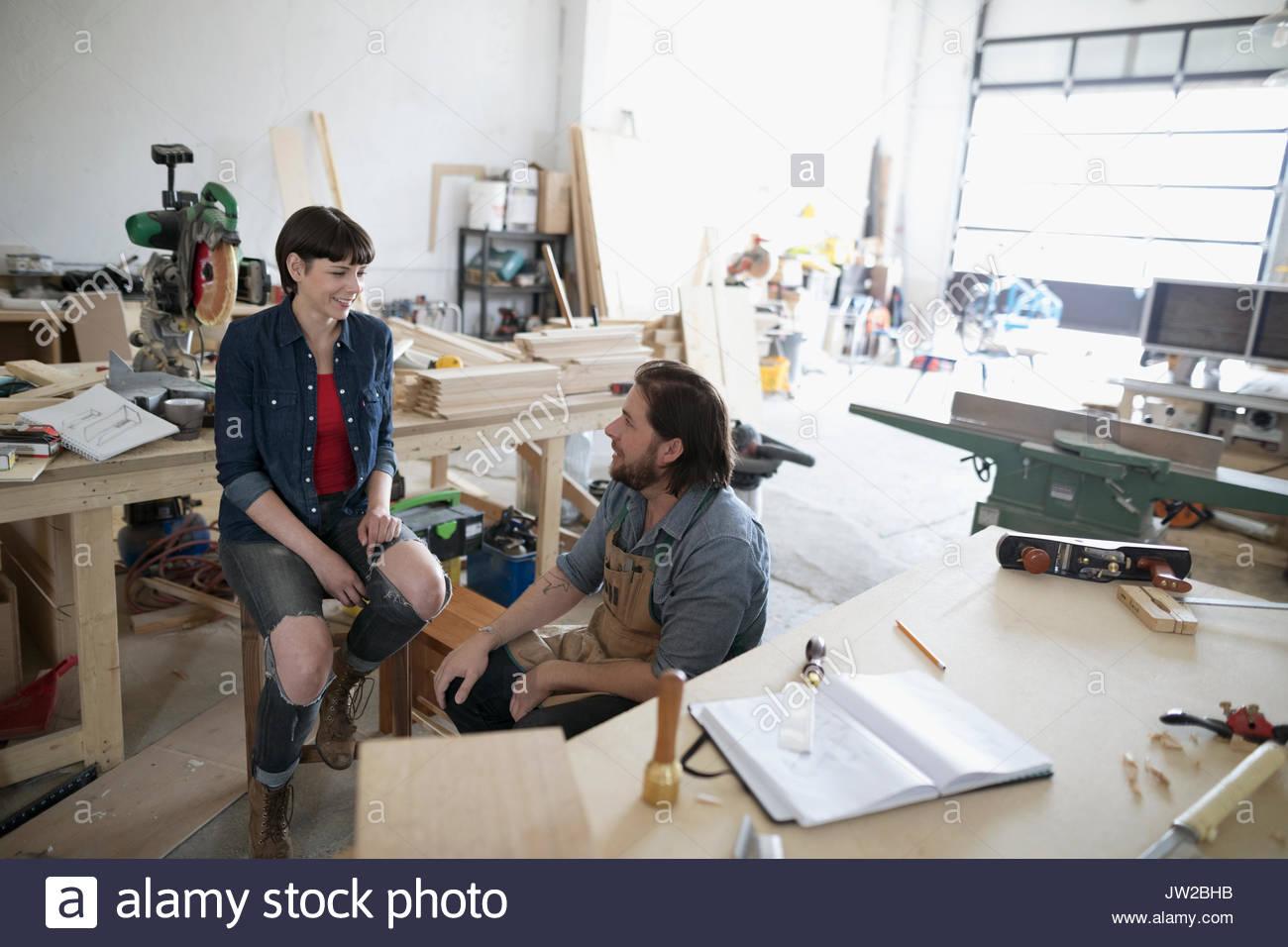 Carpenters talking in workshop - Stock Image
