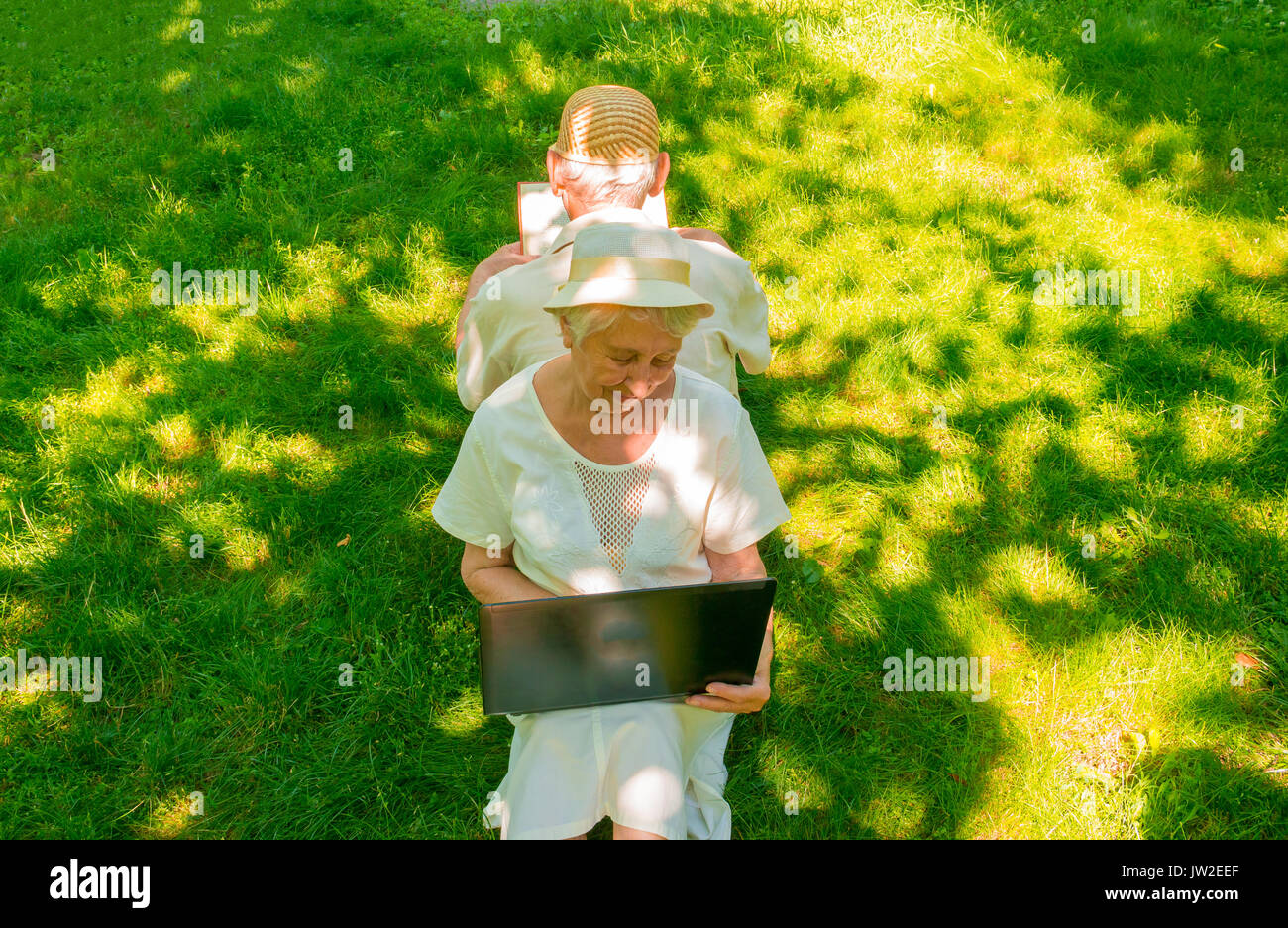 The happy old couple in the summer on a walk - Stock Image
