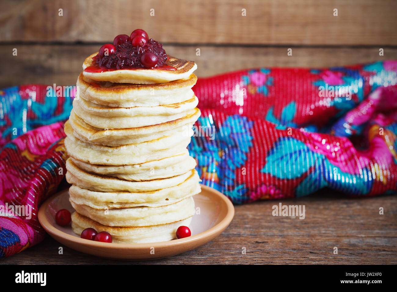 Staple of yeast pancakes from cranberry, traditional for Russian pancake week rustic - Stock Image