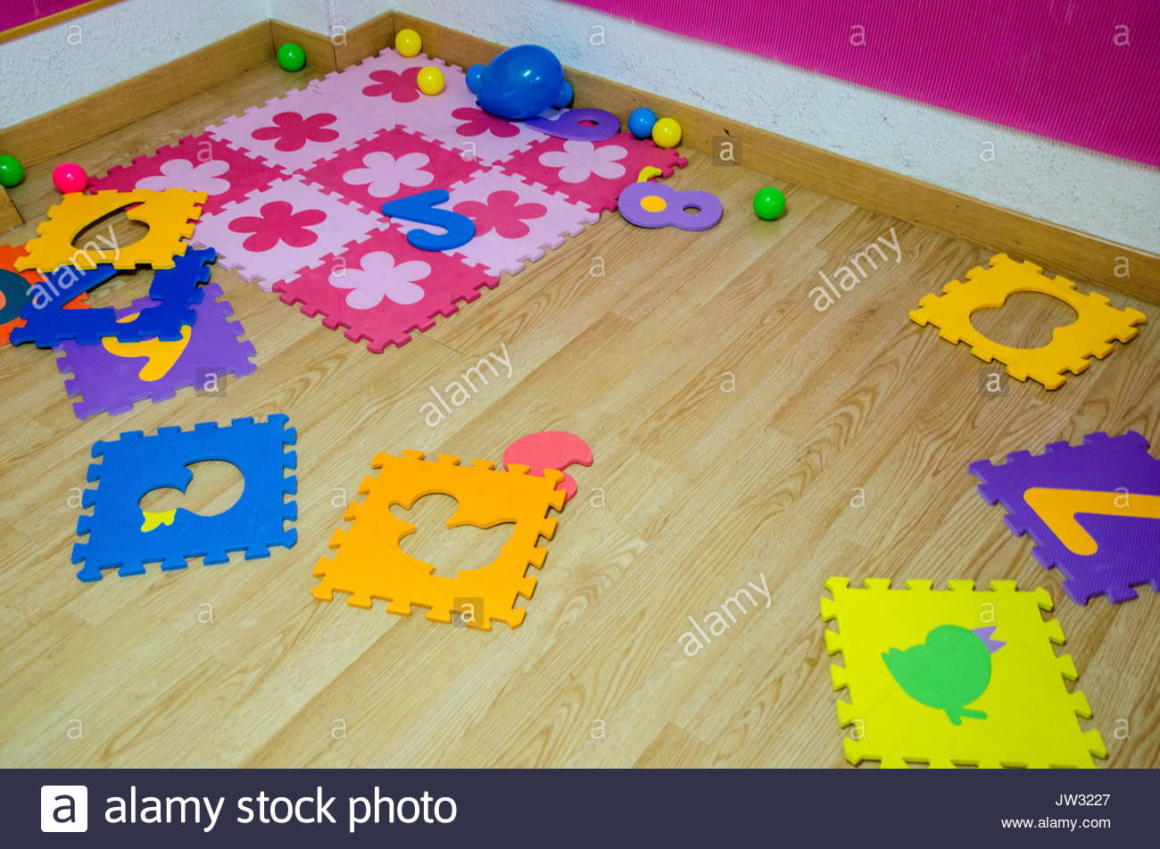 Foam Colorful Puzzle Pieces On The Ground Of The Classroom Of The