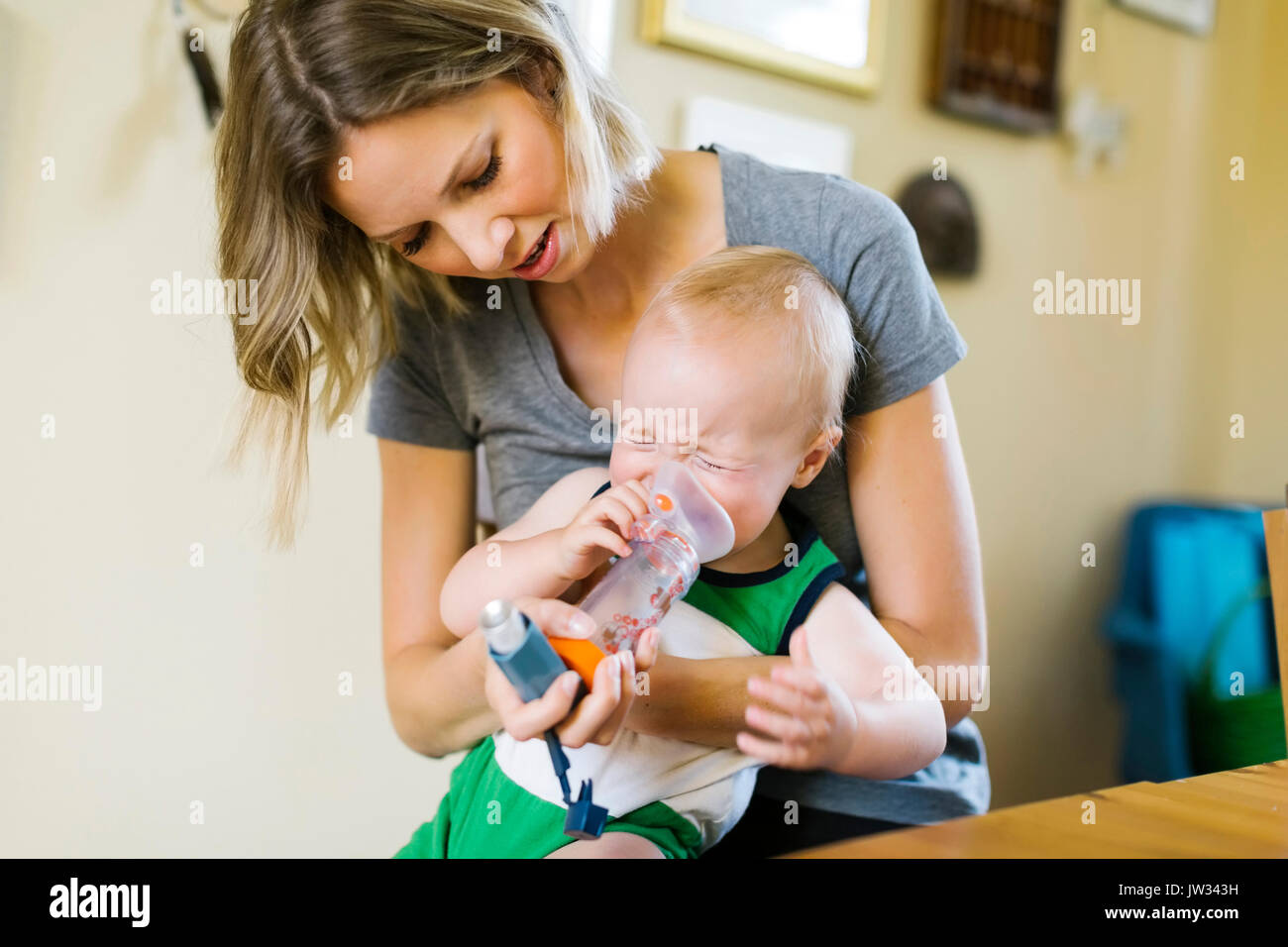 Mother inhaling son (12-17 months) - Stock Image