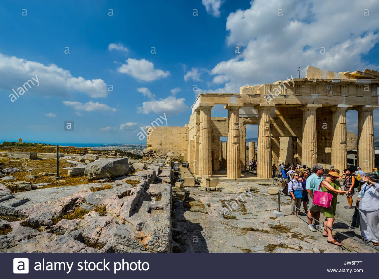 The parthenon of Athens at the acropolis with a view of the Mediterranean sea, the Philopappos Monument on Mouseion Hill and the cityh of Athens - Stock Image