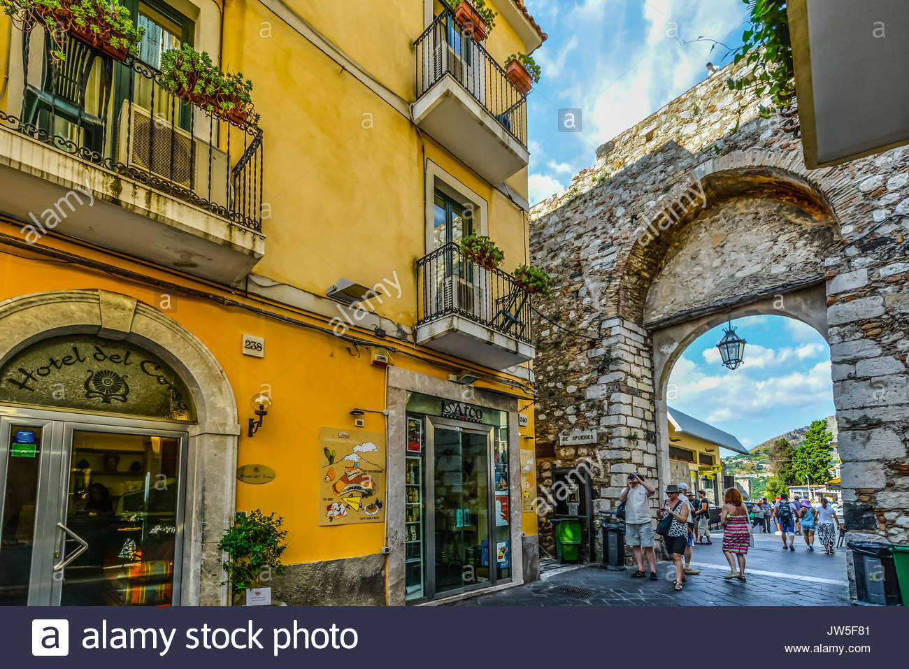The old stone city gate in the picturesque town of taormina on the the old stone city gate in the picturesque town of taormina on the island of sicily in italy voltagebd Gallery