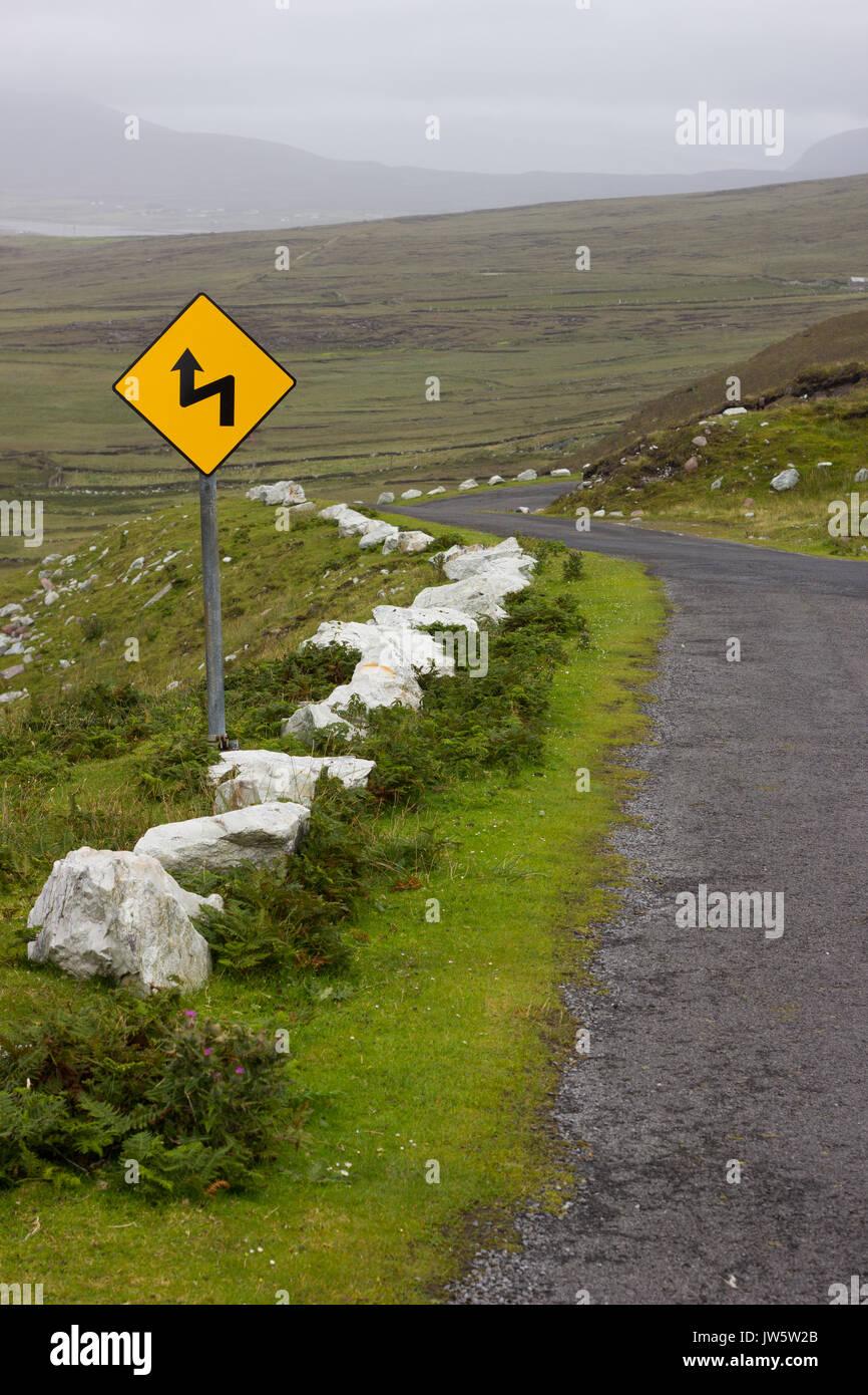 A winding road on Achill Island, Mayo, Ireland. - Stock Image