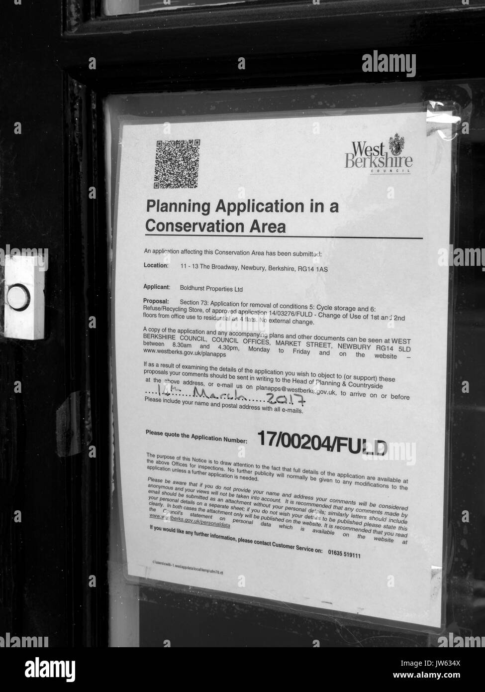 West Berkshire Council planning application in conservation area notice in retail shop window - Stock Image