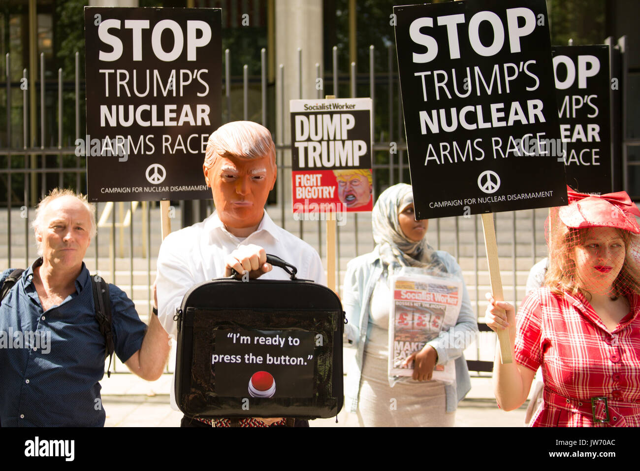 London, UK. 11 August, 2017. 'I'm ready to press the button' a person in a Donald Trump mask outside of the US Embassy as anti-war campaigners from the Stop the War Coalition and CND attempted to hand in a letter to the Embassy in Grosvenor Square, London calling for a de-escalation of the Korean crisis. David Rowe/ Alamy Live News. - Stock Image